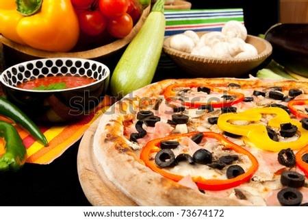 Tasty pizza and fresh vegetables - stock photo