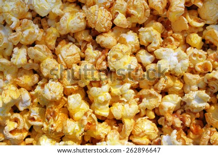 Tasty popcorn closeup background - stock photo