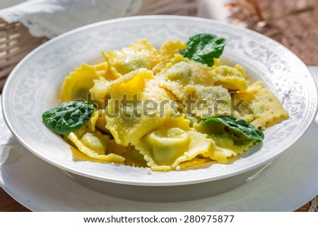 Tasty ravioli with parmesan - stock photo