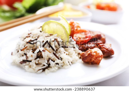 Tasty rice with meat served on table, close-up - stock photo