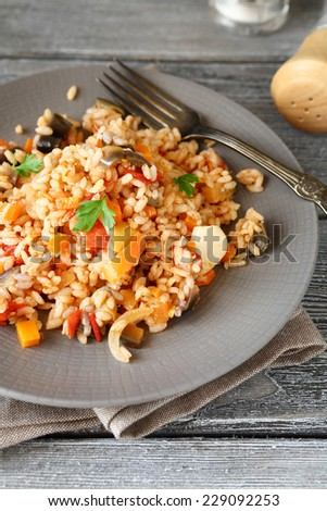 Tasty rice with vegetables on a plate, delicious food - stock photo