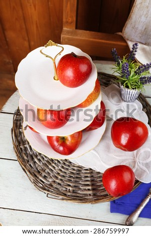 Tasty ripe apples on serving tray on table close up - stock photo