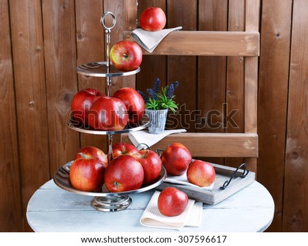 Tasty ripe apples on serving tray on wooden background - stock photo