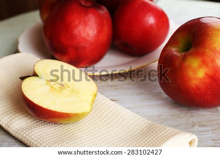 Tasty ripe apples on table close up - stock photo