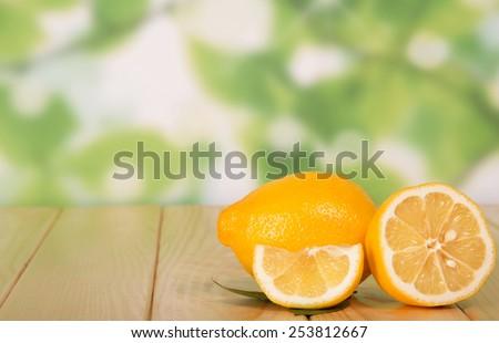 Tasty ripe lemons isolated on white background - stock photo