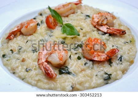 Tasty risotto with tiref prawns and special Arborio rice - stock photo