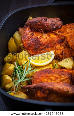 Tasty roasted pork meat with  potatoes and vegetable  - stock photo