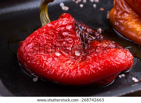 Tasty roasted red and orange bell peppers in pan  - stock photo