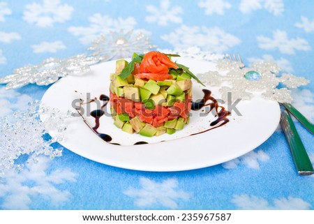 Tasty salad  - appetizer on a holiday and Christmas decor - stock photo