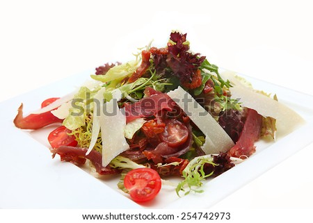 Tasty salad in white plate - stock photo