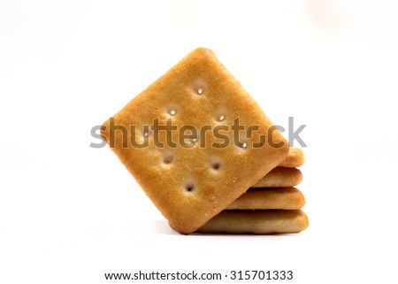 tasty salty crackers or cookies isolated on white background available with clipping path - stock photo
