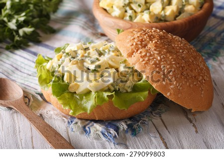 Tasty sandwich with egg salad and lettuce close-up on the table. horizontal  - stock photo