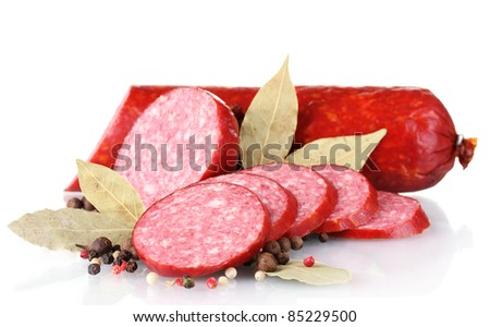 Tasty sausage and spices isolated on white - stock photo