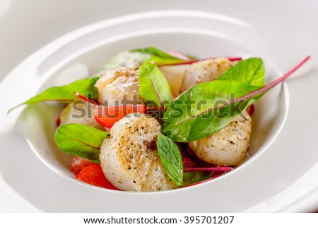 tasty scallops served with vegetables salad - stock photo