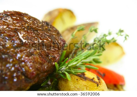 Tasty steak with potato and grilled vegetables - stock photo