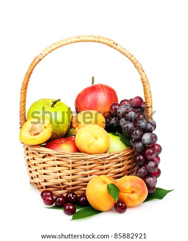 tasty summer fruits in backet isolated on white - stock photo
