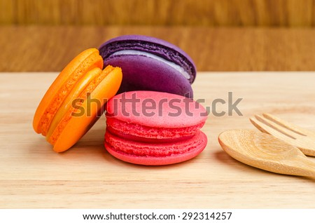 Tasty Sweet Macaroons on wooden background. - stock photo