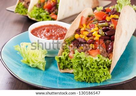 Tasty taco sandwich on the plate - stock photo