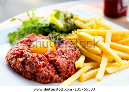 tasty tartare(Raw beef) - classic steak tartare on white plate - stock photo