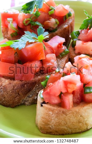 Tasty traditional bruschetta with shallow depth of field - stock photo