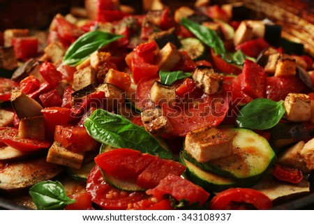Tasty vegetarian ratatouille in black cast iron pan, close-up - stock photo
