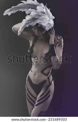 tattoo,  beautiful woman with white mask, naked and black strips - stock photo