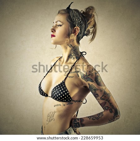 Tattooed girl  - stock photo