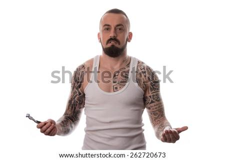 Tattooed Man Styling Beard Holding Disposable Razor - Isolated On White Background - stock photo