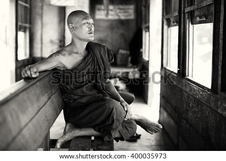 TAUNGGYI - MYANMAR - NOVEMBER 23, 2015: Unidentified Buddhist monk on November 23, 2015 in Taunggyi, Myanmar. Burma is one of the most devout Buddhist countries in the world - stock photo