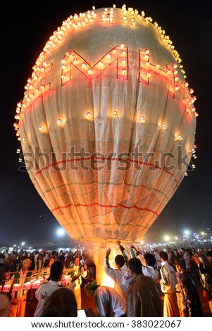 TAUNGGYI - MYANMAR - NOVEMBER 24, 2015: Unidentified Buddhist people attending the famous annual hot-air ballon festival on November 24, 2015 in Taunggyi, Myanmar.the full moon day in November - stock photo