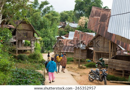 Taupe, Sulawesi, Indonesia - August 16, 2014: Group of local people involved in the primitive everyday life in traditional village of Taupe, Mamasa region, West Tana Toraja, South Sulawesi, Indonesia. - stock photo