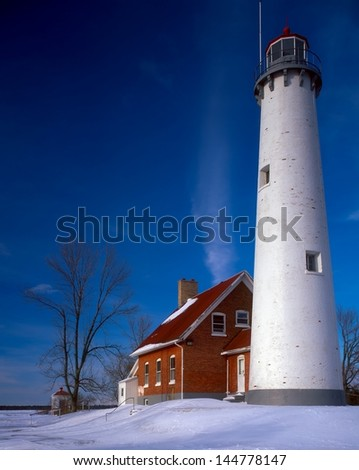 Tawas Point Lighthouse in winter - stock photo