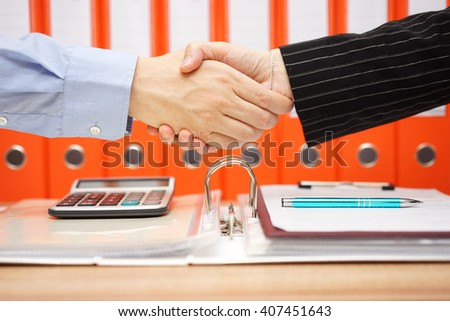 tax advisor is handshaking with satisfied client - stock photo