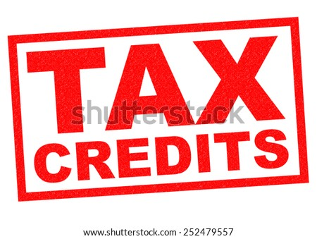TAX CREDITS red Rubber Stamp over a white background. - stock photo