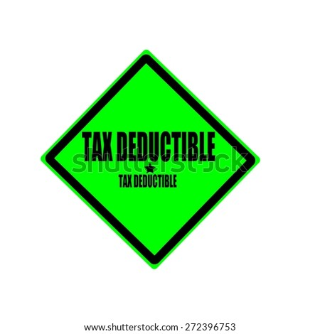 Tax deductible black stamp text on green background - stock photo