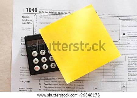 Tax form, calculator and sticker - stock photo