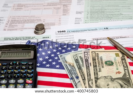 Tax Form Financial Concept with flag and money - stock photo