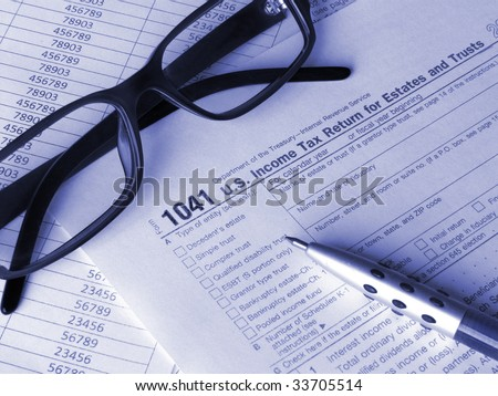 Tax form 1041 glasses and pen. Toned blue. Shallow DOF. - stock photo