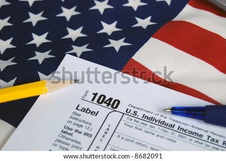 tax form on usa flag - stock photo