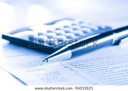 Tax form, pen and calculator - stock photo