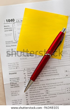 Tax form, red pen and sticker - stock photo