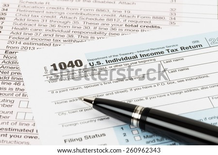 Tax form with pen taxation concept - stock photo