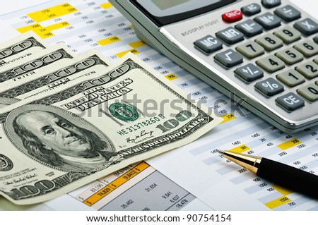 Tax forms with pen, calculator and money. - stock photo