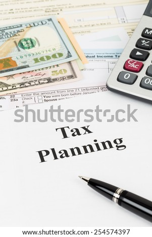 Tax planning wirh calculator and dollar banknote taxation concept - stock photo