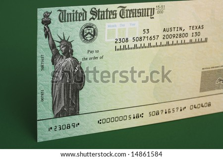 Tax refund check with a green background - stock photo