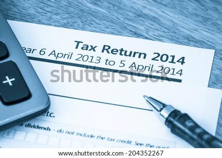 Tax return form 2014 - stock photo