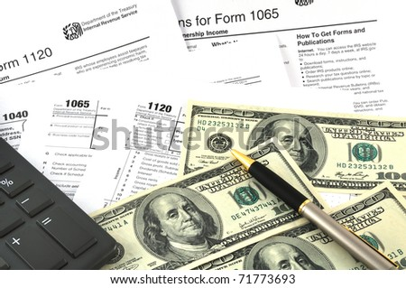 Tax Season. The concept image with a calculator, money and tax return forms. - stock photo