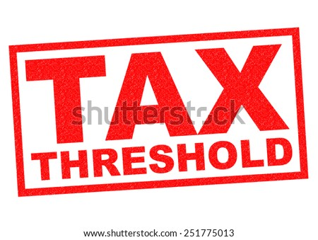 TAX THRESHOLD red Rubber Stamp over a white background. - stock photo
