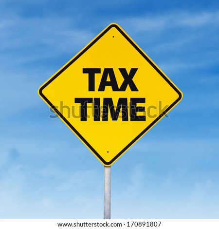 Tax time road sign on the blue sky - stock photo