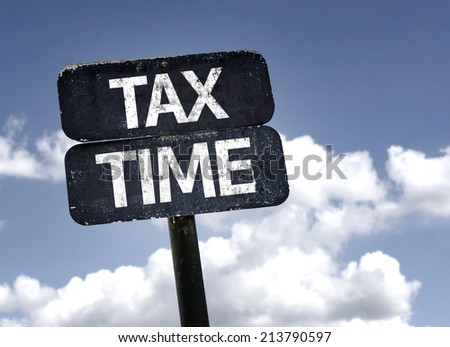 Tax Time sign with clouds and sky background  - stock photo